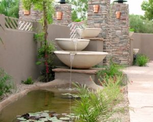 Water Fountain Pouring Into Pond